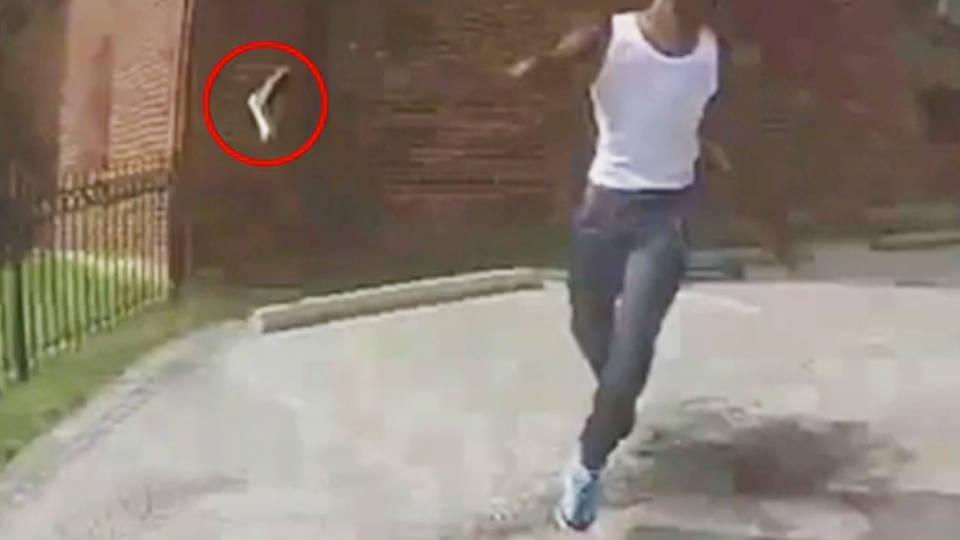 Deon Tray throwing his gun away